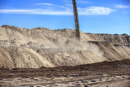 an excavation: Large excavation site with heaps of sand at day Stock Photo