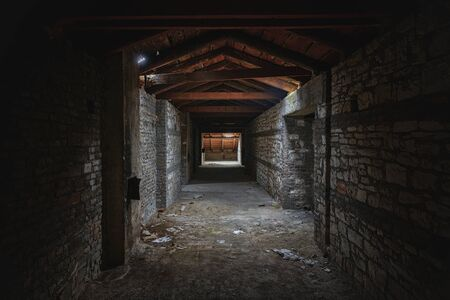 Abandoned and desolate passage made out of stone Stock Photo