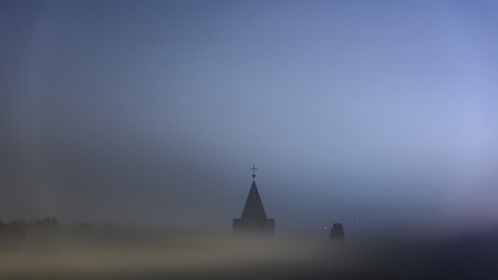 church tower: Small church tower in thick fog closeup