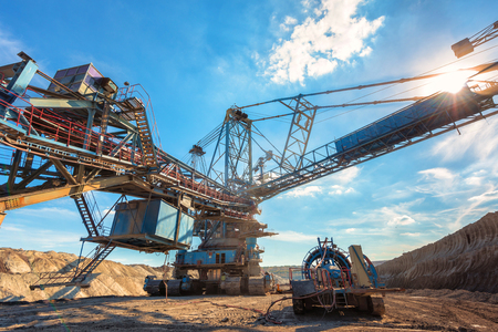 Large excavator machine in the mine working Stock Photo