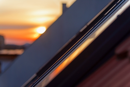 Roof tile over blue sky closeup photo