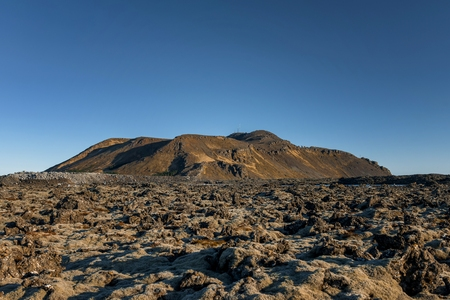 lava field: Iceland lava field covered with green moss at sunset Stock Photo