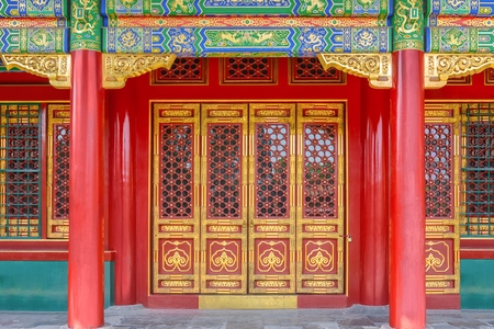 Gateway with red Chinese doors