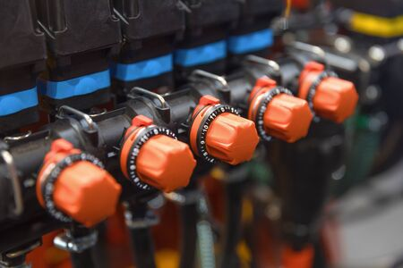 Many red valves closeup