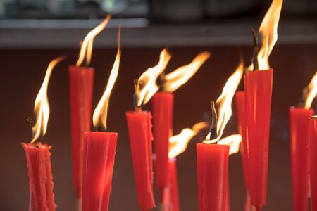 Candles at taoist shrine burning slowly
