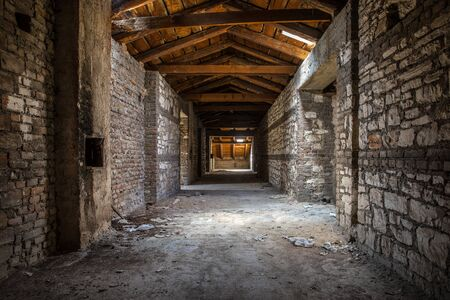 Creepy attic interior at abandoned building Stock Photo