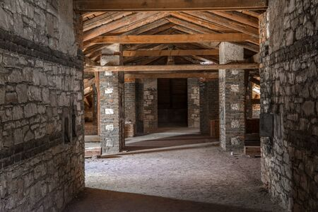 Creepy attic interior at abandoned building Stock Photo