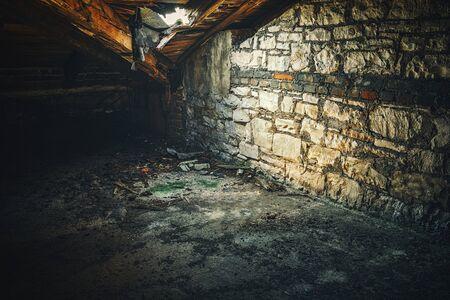 Creepy attic interior at abandoned building 스톡 콘텐츠