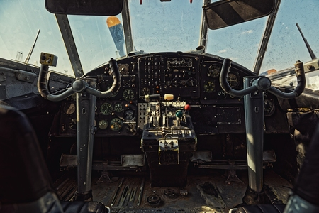 Center console and throttles in an old airplane Фото со стока