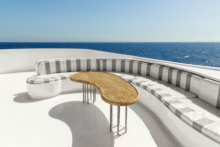 Relaxing area of luxury yacht with table