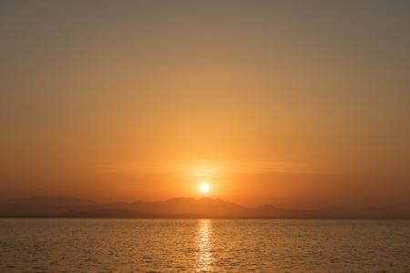 Beautiful sunset over the horizon with deep blue sea