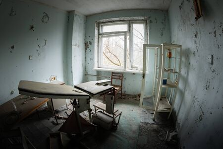Deserted Hospital room in Pripyat, Chernobyl Excusion Zone Stock Photo - 128703967