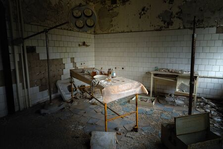 Deserted Hospital room in Pripyat, Chernobyl Excusion Zone Stock Photo - 128704191