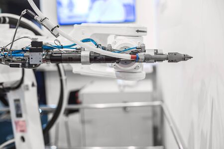 Automatic robot arm working in industrial environment close up