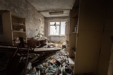 Abandoned and messy room in Pripyat post office angle shot