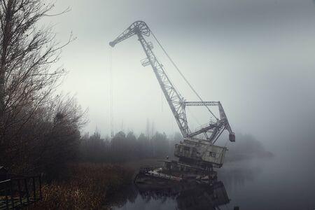 Rusty old industrial dock cranes at Chernobyl Dock