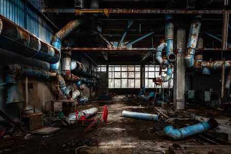 Dark industrial interior of factory in Chernobyl angle shot