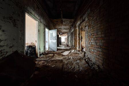 Abandoned corridor in Pripyat Hospital, Chernobyl Exclusion Zone angle shot