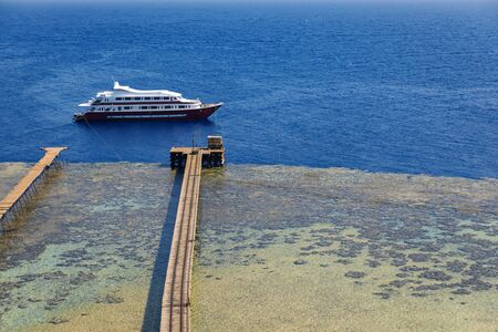 Luxury yacht parking at the pier aerial shot