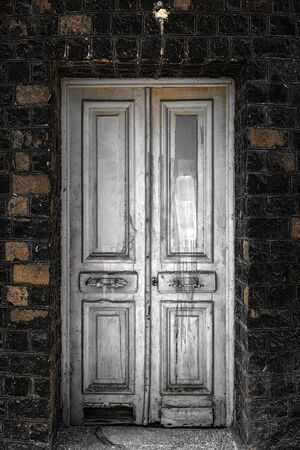 Old wooden door as background texture closeup Reklamní fotografie
