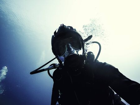 High end underwater mask on diver closeup photo
