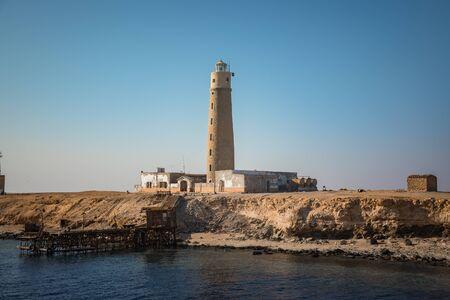 Tall lighthouse on the sea Stockfoto