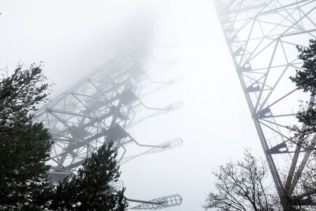 Large antenna complex in the mist Stock Photo