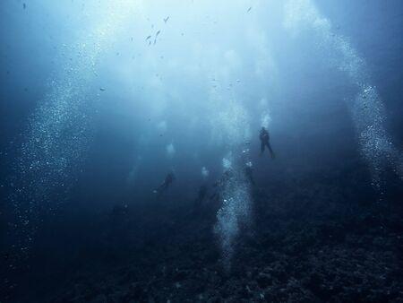 Scuba diver descending to the bottom