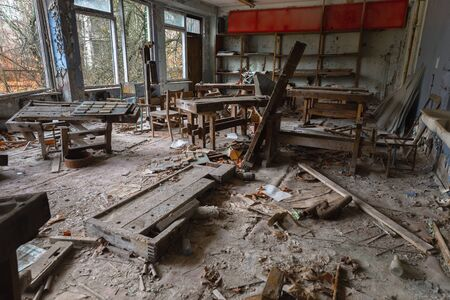 Abandoned Classroom in damaged building interior angle shot
