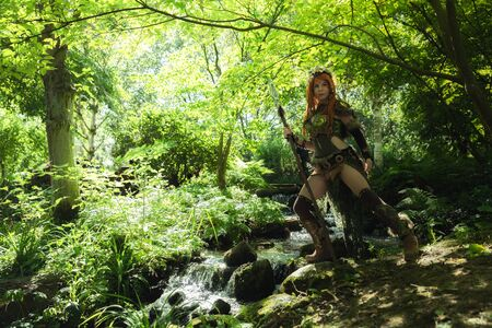 Elven warrior woman in the deep forest closeup photo