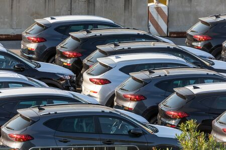 Lot of cars being transported to trade location closeup photo Stockfoto