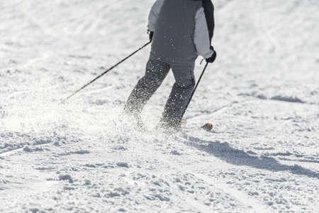 Skier sliding down on hillside