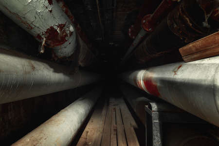 Dark underground tunnel made out of pipes Foto de archivo