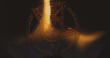 Amulet burning in the fire 120fps slow motion closeup footage Standard-Bild