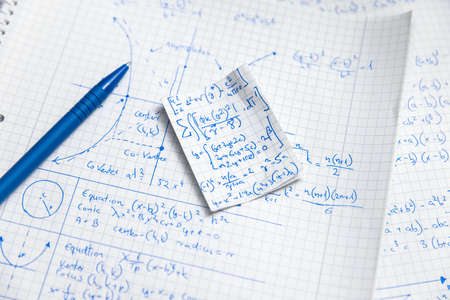 Math exersize in white notebook close up