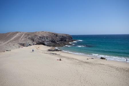 mujeres: Sandy beach and blue sea  Stock Photo