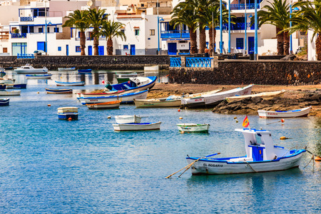Small fishing boats in the lagoon in the capital Arrecife in Lanzarote.