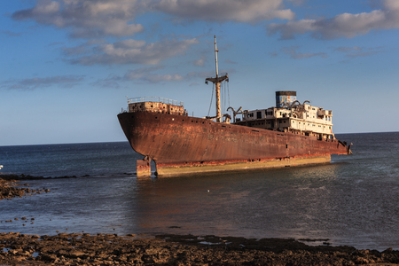 An old shipwreck located outside the capital Arrecife on Lanzarote. Stock Photo