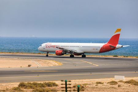 ARECIFE, SPAIN - APRIL, 16 2017: AirBus A321 of IBERIA with the registration EC-JDM ready to take off at Lanzarote Airport Editorial