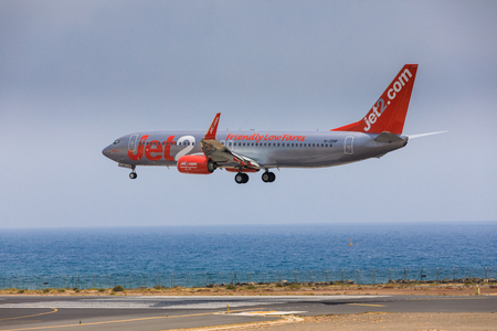 airfield: ARECIFE, SPAIN - APRIL, 16 2017: Boeing 737-800 of Jet2 with the registration G-JZHG landing at Lanzarote Airport Editorial