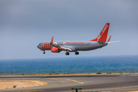 airstrip: ARECIFE, SPAIN - APRIL, 16 2017: Boeing 737-800 of Jet2 with the registration G-JZHG landing at Lanzarote Airport Editorial