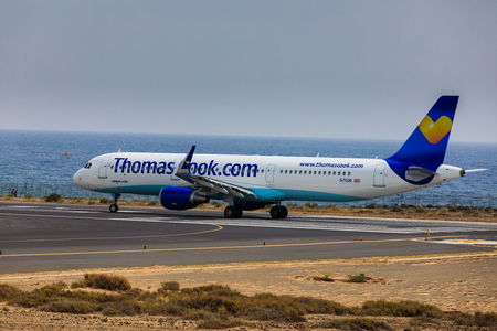 ARECIFE, SPAIN - APRIL, 16 2017: AirBus A321 of ThomasCook.com with the registration G-TCDB ready to take off at Lanzarote Airport Editorial