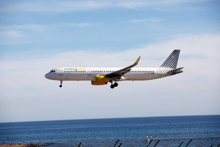 ARECIFE, SPAIN - DESEMBER, 2 2016:  Airbus A321 of Vueling landing at Lanzarote Airport Editorial