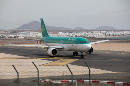 april 15: ARECIFE, SPAIN - APRIL, 15 2017: AirBus A320 of Aer Lingus ready to take off at Lanzarote Airport