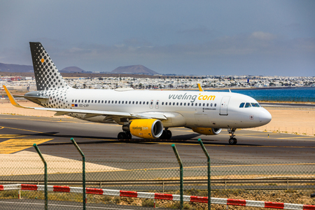 ARECIFE, SPAIN - APRIL, 15 2017: AirBus A320 of vueling.com with the registration EC-LYP ready to take off at Lanzarote Airport