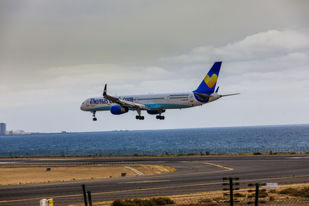 ARECIFE, SPAIN - APRIL, 15 2017: Boeing 757-300 of ThomasCook.com with the registration G-JMAA landing at Lanzarote Airport