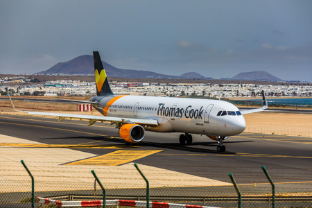 april 15: ARECIFE, SPAIN - APRIL, 15 2017: AirBus A321 of Thomas Cook with the registration G-TCDJ ready to take off at Lanzarote Airport Editorial