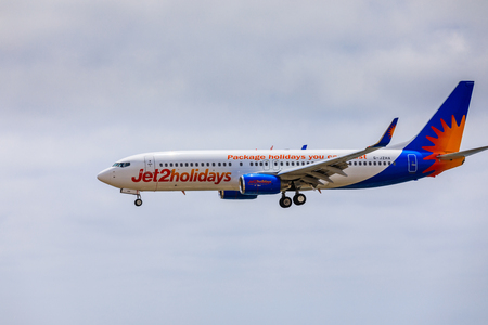 ARECIFE, SPAIN - APRIL, 15 2017: Boeing 737-800 of Jet2holidays with the registration G-JZHA landing at Lanzarote Airport
