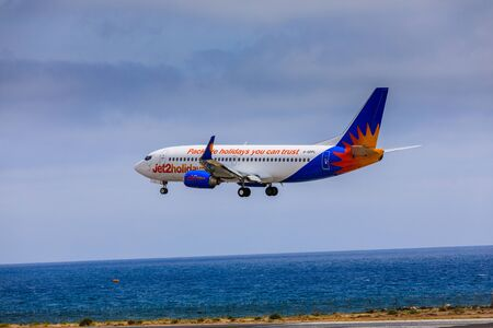 april 15: ARECIFE, SPAIN - APRIL, 15 2017: Boeing 737-300 of Jet2holidays with the registration G-GDFL landing at Lanzarote Airport
