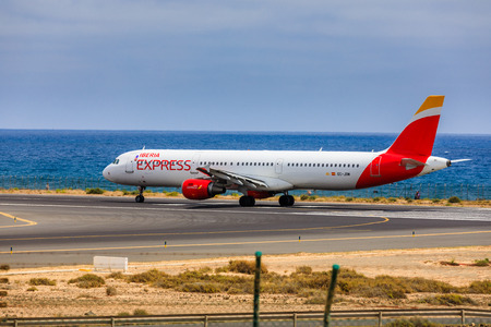april 15: ARECIFE, SPAIN - APRIL, 15 2017: AirBus A321 of IBERIA with the registration EC-JOM ready to take off at Lanzarote Airport